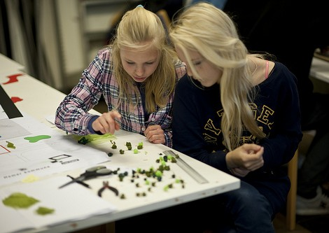 Lise Evandsen, age 14 and Karianne Lillegerg, age 13 work on their model for the Cultural Rucksack